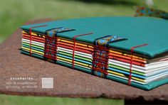 colorful coptic binding over ribbons {turquesa multicolor} | by Maria Elvira Steibel