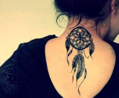 http://tattoomagz.com/dream-catcher-tattoos/black-dream-catcher-tattoo-on-back/
