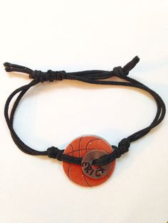 Basketball washer bracelets: Last version! Used scrapbook paper with basketballs glued onto washers and covered with Mod Podge dimensional. The name is hand-stamped on washers. Cord is Chinese knotting cord. Basketball Crafts, Basketball Jewelry, I Love Basketball, Basketball Party, Soccer, Basketball Coach, Coach Gifts, Team Gifts, Washer Crafts