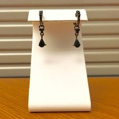 Black Rhinestone Earrings Very classy jewelry. Gunmetal gray hardware with black faceted rhinestones decorating the hoops and the charm. Classic yet edgy. Hinge and post closure. Open to reasonable offers! Jewelry Earrings