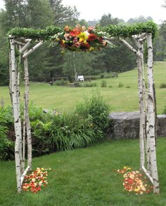 I want this. But half the height, minus the greenery, across two round welcome tables for the sign in and place card settings!