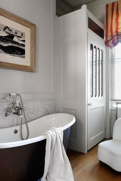 Fab bath with a red and white stripe relaxed roman shade and love the cabinet.