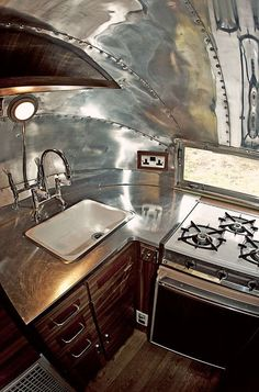 Stainless Steel Counters in Airstream Trailer; note the dark wood with the stainless, LOVE it!