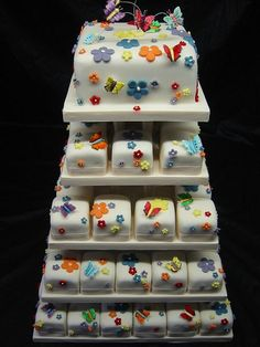 How about a top tier then individual petite fours? Very cute!