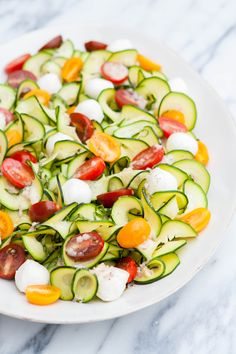 This Zucchini Tomato Basil Salad with Lemon Basil Vinaigrette is a light and refreshing summertime salad and perfect when your garden is exploding with tomatoes, basil, and zucchini in the later summer months. Tomato Basil Salad, Zucchini Tomato, Zucchini Salad, Zucchini Ribbon Salad, Healthy Zucchini, Summertime Salads, Summer Salads, Summer Food, Vegetable Recipes
