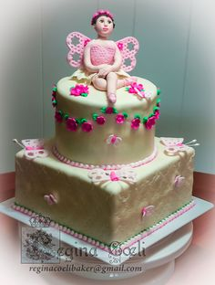 Girly ballerina fairy cake. Covered and decorated with fondant.