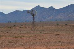 This windmill is dwarfed by the Flinders Ranges