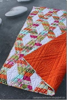"""Tamarack Shack take on a Jaybird quilt, """"Hugs and Kisses"""".  Like the loose quilting, & the pattern it makes on the cozy orange flannel back."""