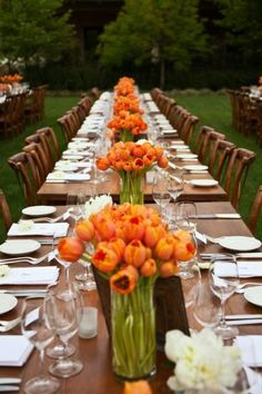 Tablescapes.  Like the slight spacing between tables and simple flowers