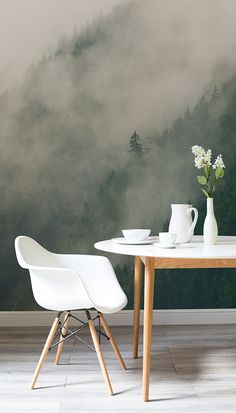 Create the perfect backdrop to wintry dinner parties with this forest wallpaper. Clouded treetops give a theatrical feel to this room while white furnishings help to create a clean and pure aesthetic.