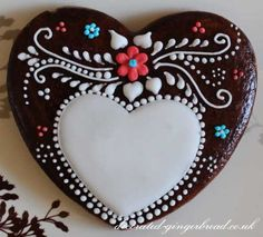 White icing on brown heart