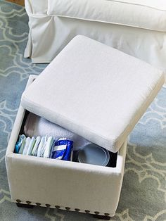 Stocked with everything from diapers to throws, a lidded ottoman keeps essentials close at hand but out of sight.