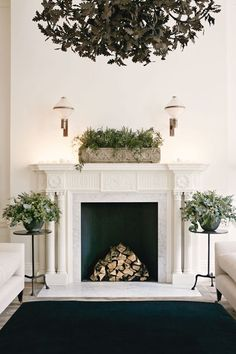 Christmas decoration for the minimalist. In this sitting room designed by Rose Uniacke, floral designer Nikki Tibbles of Wild at Heart has created arrangements to complement the simplicity of the interiors.
