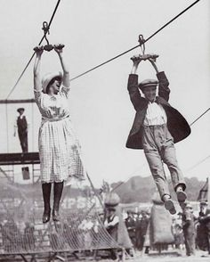 11.) A couple enjoys an old-fashioned zipline at a fair (1923).