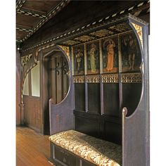 A wooden bench with painted panelling at Wightwick Manor.