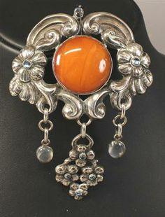 Georg Albert Halling. Skonvirke silver and amber brooch.