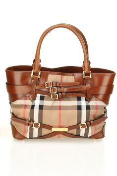 Burberry. Just bcoz Mommy Bubbles have this exactly the same bag. ;)