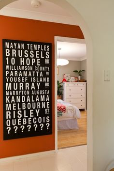 """Maya's bedroom. A bus-scroll inspired sign (that also happens to be a secret marriage proposal!) leads the way to a quirky little retreat.  Walls painted with Dulux """"Still"""" in half-strength."""
