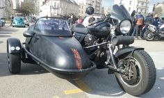 Moto Guzzi sidecar rig with leading link front suspension and car tire