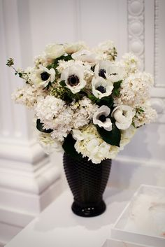 Lovely black and white floral arrangement in black vase via Heavenly Blooms. White Floral Arrangements, Wedding Flower Arrangements, Flower Centerpieces, Wedding Centerpieces, Black And White Flowers, White Wedding Flowers, Floral Wedding, Black White, Exotic Flowers