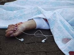 This girl was listening to music when she committed suicide. I'm speechless.