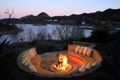 Outdoor built in rock seating and fire pit. Lake Sherwood Residence.