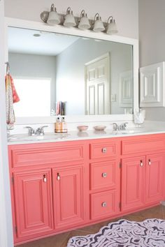 Would be great for a girl's bathroom. This is really pretty. The gray walls, framed mirror, coral cabinets. Sherwin Williams - coral design and decoration de casas interior design ideas Bad Inspiration, Bathroom Inspiration, Bathroom Ideas, Bathroom Storage, Bathroom Renovations, Restroom Ideas, Bathroom Interior, Gray Interior, Design Bathroom
