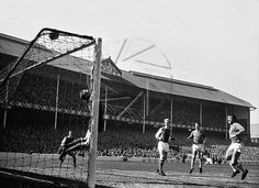 5th April 1968. Everton's Johnny Morrissey sees his shot tipped over the bar by Arsenal goalkeeper Bob Wilson, at Goodison Park.