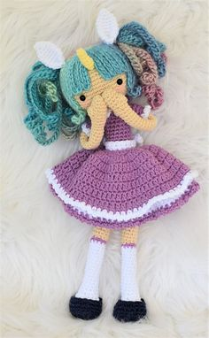 Note: This listing is for a crochet pattern only - it is not the finished doll! Zoe the Unicorn Girl is crocheted from the bottom of her feet to the top of her head as one piece, even the arms are joined to the body. You will need to know basic to intermediate crochet and