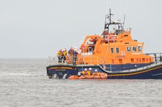 """RNLI Tynemouth Lifeboat, """"Spirit of Northumbria"""" carries out a simulated rescue at Littlehaven Harbour as part of the opening day celebrations."""