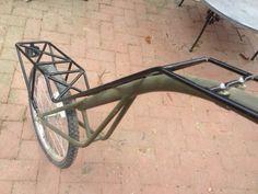 Single wheel bike trailer for backpacks and more.