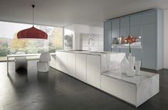 Simplicity does not negate luxury, as can be seen in this marble countertop kitchen.