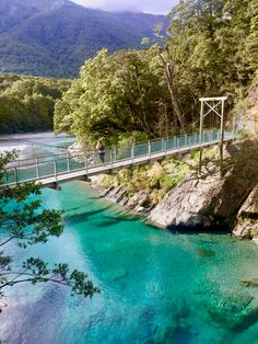 Bridge over turquoise blue water in Mount Aspiring National Park, New Zealand