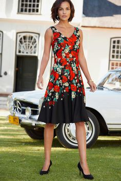 Signature Floral Print Dress - This dress features a beautiful poppy print, fitted bodice and pleated skirt providing a flattering silhouette, finished with a v neck and zip fastening. A perfect style for a special occasion.