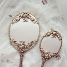 She picks up the carved mirror and stares at its delicate framing around the fragile glass. Her reflection stares back at her, a girl, 15, with long wavy dark brown hair and the deepest chocolate eyes one could ever see.