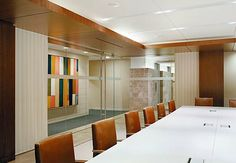 contemporary office with dark wood accients   ... that is linked to the long history of the firm with dark wood accents