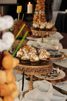 my dessert table. just a few of my favorite things: donut towers, s'more cupcakes, truffles, oatmeal choc. chip bites, centerpiece is an edible creation arrangement (apple and pear truffles!)