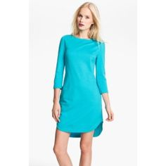 Trina Turk 'Sculptor' dress Gently loved Trina Turk 'sculptor' dress was worn less than a handful of times. This turquoise scoop neck dress features long sleeves, rounded hem, is fully lined and has an exposed gold zipper on the back. Whether it's a first date or the first day of work, the versatility of this dress has you covered! Trina Turk Dresses Midi