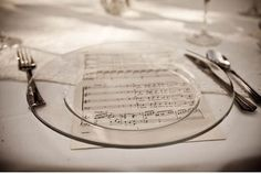 Wedding placemats-purchase sheet music or a sheet music book from a thrift store and use a paper cutter to ensure straight edges; inspiration, DIY wedding, budget wedding, centerpieces, decor, inspiration board