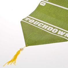 Football Field Table Runner by Century Novelty. $3.95. Score a Touchdown With Football Decorations. Complete any football party or banquet with the Football Field Table Runner. This football table decoration is a great way to put points on the board at your football party, tailgate event, or Super Bowl celebration! Football runner is approximately 72 x 11. Yellow tassels at both ends. Glossy finish. Made of paper. Football decorations are great additions to yo...