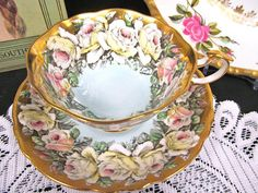 OFFERING THIS PRETTY TEA CUP AND SAUCER MADE BY PARAGON THIS SITS ON A FOOTED BASE HAS A FANCY HANDLE ,AND BLUE WITH BANDS OF GOLD GILT AND PAINTED ROSES AS WELL I DID NOT SEE ANYTHING WRONG AND PINGS PERFECT MADE OF A FINE BONE CHINA LARGE WIDE MOUTH WITH NO WEAR AND NO FADING AND NO