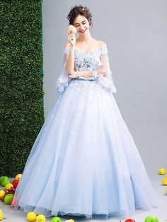 [Click through and take a look at the other views of these sleeves (there's a down arrow you have to use to see the view of the back and the trim).  They're unusual and very pretty.]   Light Blue Off Shoulder Floral Applique Ball Gown Prom Dress