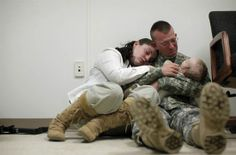 U.S. Army Sgt. Brian Keith sits with his wife, Sara, and their son, Stephen, 6 months, before he is deployed to Afghanistan with other troops from Fort Drum, N.Y., on March 29th 2010.