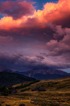 ✮ Clouds above 14,000 foot Wilson Peak illuminates in a fiery light as the sun starts rising above the horizon