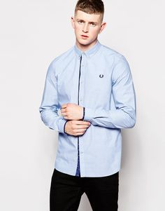 """Shirt by Fred Perry Breathable cotton Fastened collar Button placket with c ontrast trim Embroidered logo Regular fit - true to size Machine wash 100% Cotton Our model wears a size Medium and is 185.5cm/6'1"""" tall"""