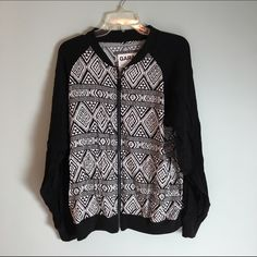 Black&White Garage Zip Up Good condition. Size large. Runs big for a juniors large. Thin. •Smoke Free Home •15% off bundles through PM feature or •Ask me the best I can do on a bundle!! •The more you bundle; the better the deal •Fast Shipping •Free Gift(s) over $10 purchase Garage Tops Sweatshirts & Hoodies