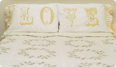 Nothing says love like these romantic pillows from Beverly at Flamingo Toes. Literally! Beverly used a freezer paper stencil that she cut with her Silhouette to add the lettering to her pillowcases and then sewed some shabby ruffles to the edges. While I had Valentine's Day on the brain when I looked at these, Beverly also points out that they would make fabulous wedding or bridal shower gifts.