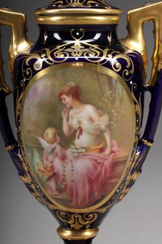 """An early 20th century Austrian cobalt blue Royal Vienna lidded vase. Hand painted with a beautiful painting of """"Cupid and Nymph"""""""
