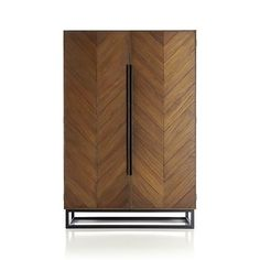 I don't really need another piece of furniture in my life. I just really love the parquet style wooden chevrons on the front of this.