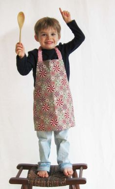 Adorable children's apron with genius elasticized neck strap from Beth Galvin at Craftsy. Years ago, I saw this child's apron with elastic in the neck, and I've been using it for adult aprons as well ever since. No sliding D-rings, no messy ties -- brilliant.